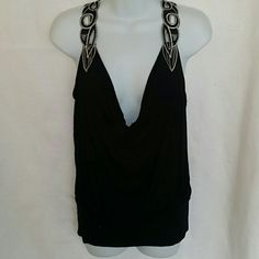 Sassy XXI Black top with fancy silver racer back Black sassy top with silver and black racer design feels soft and sexy on. NWOT. Never worn. Forever 21 Tops Blouses