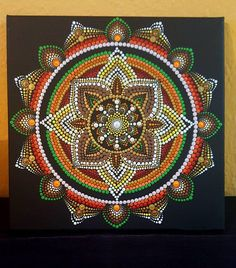 ** I will always combine shipping! If you purchase multiple items, I will work with you on the shipping. When buying multiple items I promptly refund any postage overages.**** The black background provides a stark contrast so that the mandala jumps out. Canvas size :30x30cm. Ready