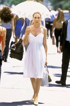 Carrie looking lovely in a white vintage sundress and parasol.
