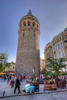 The Galata Tower (Galata Kulesi in Turkish) — called Christea Turris (the Tower of Christ in Latin) by the Genoese — is a medieval stone tower in the Galata/Karaköy quarter of Istanbul, Turkey, just to the north of the Golden Horn's junction with the Bosphorus. One of the city's most striking landmarks, it is a high, cone-capped cylinder that dominates the skyline and offers a panoramic vista of Istanbul's Historic Peninsula and its environs.    http://en.wikipedia.org/wiki/Galata_Tower