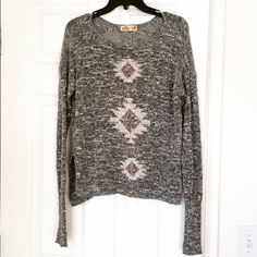 Hollister Tribal Sweater Adorable gray Hollister sweater. Has open slits on the sides. Gently worn but in great condition. Size XS/S Hollister Sweaters Crew & Scoop Necks