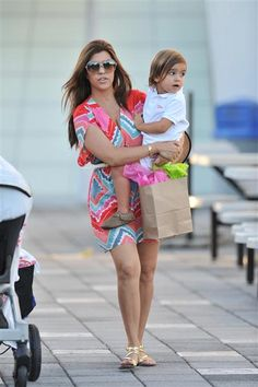 Kourtney Kardashian keeps her looks casual in a colorful summer dress and gold sandals while she takes her son Mason to a museum in Miami on Oct. 3, 2012. See more celebs on Wonderwall. http://on-msn.com/T6cwfS