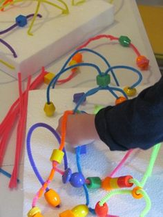 pipecleaners and beads.  Teach Preschool is a great site.