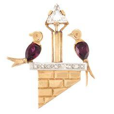 Brooch 1945 Doyle Auctions  Gold, Diamond and Garnet Love Bird Pin  One triangular-cut diamond ap. .50 ct., rose-cut diamonds, c. 1945, ap. 4.5 dwts.