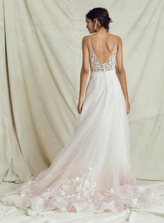 A sweet symphony of beauty and love, this stunning ombre floral embroidered wedding gown hits all the right notes. The bold melody of floral embroidery that floats along the hem of the tulle skirt harmonizes with the exquisite lace details of the bodice and deep-V back. The glissando from ivory into blush gives this light and slimming floral wedding gown a graceful rhythm that rocks worlds. Ombre Wedding Dress, Wedding Dress Gallery, Bridal Wedding Dresses, Tulle Wedding, Floral Wedding, Kelly Faetanini Wedding Dresses, Designer Wedding Gowns, Bridal Collection, Nice Dresses