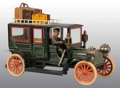 Tin Hand-Painted Carette Limousine Wind-Up Toy.