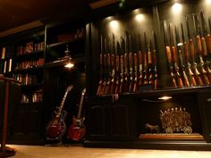 built in lighted gun cabinet with bookcase and guitar display, this has my boyfriend written all over it lol