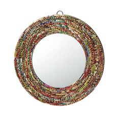 This handcrafted decorative mirror will add color to your home décor. The frame is made entirely of sparkly bits of broken bangle bracelets.