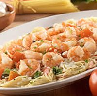Olive Garden Recipe: Grilled Shrimp Caprese. Need: Roma tomatoes (1 1/2 lbs), basil leaves, EVOO, garlic (1T), Italian seasoning, salt, butter (2T), white wine (1/2 C), heavy cream (1 1/2 C), parmesan cheese (1C), mozzarella cheese (2C), angel hair pasta (1 lb), shrimp (1 lb)