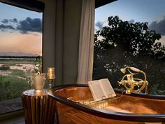 Great Plains Conservation's Zarafa Camp debuted its solar-powered Dhow Suites in the heart of northern Botswana's Selinda Reserve. African Safari, Luxury Travel, Lodges, Places To Travel, Camping, Luxurious Bathrooms, Conservation, Honeymoons, Copper Bathtub
