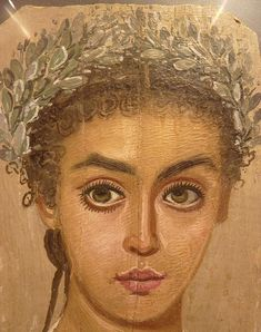Roman era Egyptian mummy portrait of a young woman. Coptic period; probably from Fayum. Encaustic on panel.