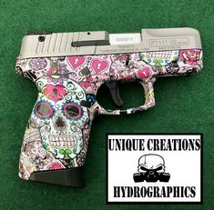 """9mm Taurus Hydrodipped in Sugar Skulls finished in gloss!  Check us out on Facebook! https://www.facebook.com/UniqueCreationsHydrographics/  """"You Think it, We Dip it!"""" -Unique Creations Hydrographics"""