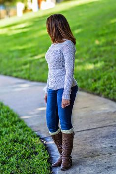 knitted sweater and riding boots combination.