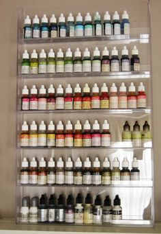 here is an easy way to keep all of your reinkers at your finger tips! Pun Intended...Use a nail polish rack!