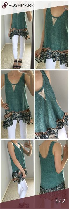 Green Tribal Ruffle Tank Brand new without tags. Absolutely gorgeous!! Stunning green top with cut out lace at chest and tribal print flowy ruffled bottom. So unique and so gorgeous on. Easy to dress up or down. Ruffle is polyester and top is cotton polyester blend. Fits a bit oversized. I'm modeling the small and there's still a bit of room at the chest. Love it! Tops Tank Tops