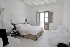 I love the the idea of using over-sized artwork as a headboard! This is the Anemi Hotel in Greece, and their color choices are just gorgeous. Photo Headboard, Canvas Headboard, Cozy Small Bedrooms, Small Bedroom Designs, White Painted Floors, Small Bedroom Inspiration, Hotel Apartment, Apartment Therapy, Minimalist Room