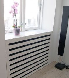 Use these radiator cover ideas to transform your room. See how to use a radiator cover for storage, reading nooks under windows, corner cabinets + more. Best Radiators, Home Radiators, Radiator Screen, Radiator Heater, Modern Radiator Cover, Contemporary Radiators, Classic Cabinets, Room Decor, House Design