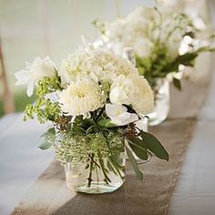 Wedding Table Centerpieces | Fragrant White Centerpiece | SouthernLiving.com White mums, hydrangea, Queen Anne's lace, irise, roses, seeded eucalyptus