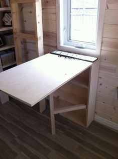 lydias-tiny-house-4- Like this collapsible table with shelves under it!