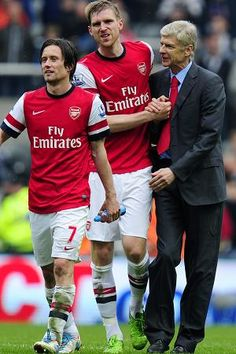Manager Arsene Wenger of Arsenal celebrates at the final whistle with Tomas Rosicky (L) and Per Mertesacker (C)