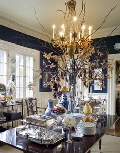 Ana Rosa  Floral arrangement reaches up and beyond the chandelier