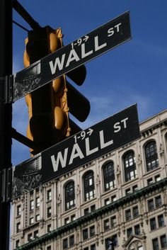 Wall street sign.   Oh yes, will be there this year when we go public!!     Travel photo by Katja Presnal