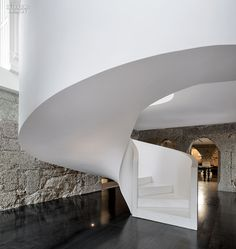 A Staircase in reinforced concrete, with Namibian Marble steps, rise from the Cor-Ten steel floor of the lowest level.