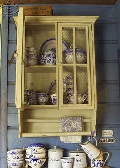 vintage kitchen nook- painted wall cabinet with chicken wire- blue and yellow
