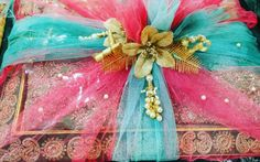 #1stchoicegift #trousseaupackaging #bridal#weddingseason #sareepacking#suits#lengtha#ethnicwear#traditions#pearl&gold#decorations Facebook.com/1stchoicegift Trousseau Packing, Gold Decorations, Money Envelopes, Baskets, Pearl, Fancy, Suits, Facebook, Bridal