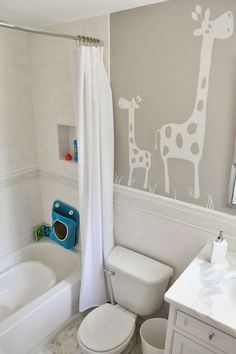 love this simple mural for a kids space, and especially love it in the bathroom