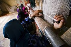 ARZU weavers working at the loom