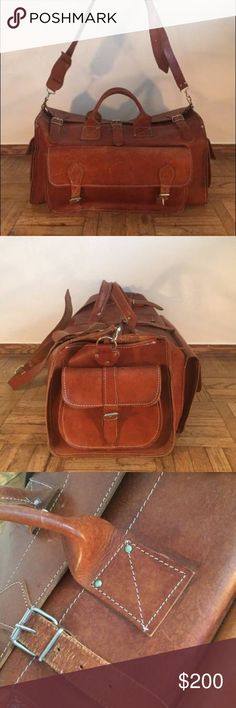 """VINTAGE LEATHER DUFFLE BAG TRAVEL BAG VINTAGE LEATHER DUFFLE BAG - TRAVEL BAG - SUITECASE - BAGAGE   Product Description: Vintage genuine leather duffle bag with one large pocket on the front and two little pockets on the side. The bag has one long handle to carry on the shoulder and two little handles to carry by hand. The travel bag is an excellent condition with a beautiful warm brown patina.    Product Information: 23"""" L x 13"""" W x 10.5"""" D  Pick up address: 655 E. 14th St. New York, NY…"""