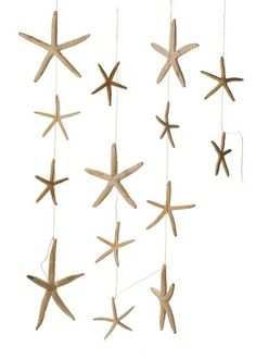 String a few starfish and hang around your wedding venue. To find out how to create your own starfish for this garland, follow the DIY Salt Dough Starfish Garland recipe from The Desperate Craftwives.
