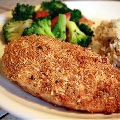 SUBMERGE CHICKEN IN A STRONG GARLIC-OLIVE OIL INFUSION, THEN COAT WITH PARMESAN AND BREAD CRUMBS FOR A QUICK AND SUBLIME BAKED CHICKEN.