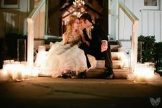 take a moment during your reception and escape, just the two of you, for a quick photo session. Nighttime   candles, what a romantic look!