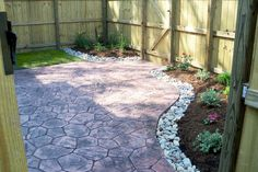 townhouse backyard with stamped concrete patio and simple landscaping