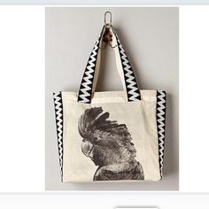 """Anthro tote Bonnie and Neil (Anthropologie) cockatoo bird fauna canvas tote shoulder bag. Features one inner pocket. 15""""H 20""""W 4""""D, 10.5"""" strap drop. Excellent condition, no flaws. Super cute and versatile! Originally $128. Anthropologie Bags Totes"""