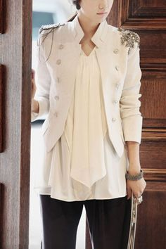 Coat crafted in terylene, featuring pure color, standing collar, long sleeves, double breasted button front, all in mini length cut.