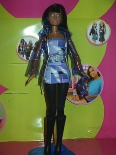 NEW Fashion Fever african-American Kayla Doll in Purple Dress, See-thru Jacket, Black Tight and Boots. Taking her fashion cues from the world of Hollywood, this Fashion Fever Kayla is sure to turn some heads.
