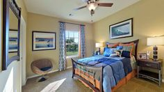 The rattan chair works well in this surfer's paradise themed bedroom in the Long Meadow Farms model home. Schedule a tour today! #NewHomes #Houston
