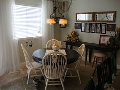 Small dining room idea. Got the table for $25 at an outlet store and painted it black. Got the chairs at a yard sale for about $5 each and painted them cream. Have been using them for over 10 years and still love them. Mostly because I don't care if the kids ding them or or hard on them. Love my long black console table against the wall with the pictures and mirrors above it.
