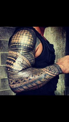 Roman Reigns tattoo. love his arms