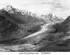 Vintage black and white analogue film photo of Zanskar Glacier Drang Drung, near Pansi-La pass (4350m), part of the Great Himalayan Range, located in Zanskar region, northern India.