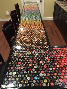 Five Years Worth of Bottle Cap Collection Turned into an Awesome Countertop! diy bar Build an awesome custom bottle cap bar top Custom Bottle Caps, Bottle Cap Art, Custom Bottles, Bottle Cap Crafts, Bottle Cap Table, Bottle Labels, Beer Cap Table, Bottle Cap Coasters, Beer Cap Crafts