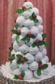 create your own edible Christmas tree  centerpiece use a styrofoam cone put on pretty plate with pretty doily and stick toothpicks into it and stick on a small powdered sugar donut hole and layer until it is how you want it.  Then add cranberries and mint leaves.