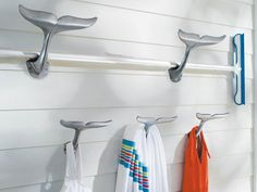 Whale hooks from Frontgate.com provide perfect poolside storage for bathing suits, towels and water toys. Larger hooks mounted vertically can hold pool maintenance tools.