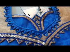 Lets learn how to stitch a very simple back neck design of a blouse. You all can try stitching the back blouse design by watching this video simultaneously. This is a very easy and simple design of a back blouse. Latest Blouse Neck Designs, Simple Blouse Designs, Saree Blouse Neck Designs, Stylish Blouse Design, Dress Neck Designs, Bridal Blouse Designs, Sari Blouse, Saris, Patch Work Blouse Designs