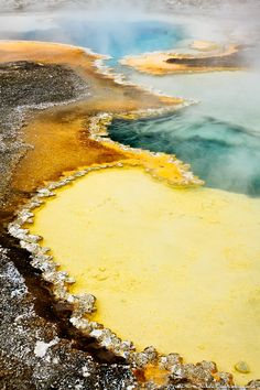 Amazing colors form in the water of Doublet Pool in the Upper Geyser Basin of Yellowstone National Park.