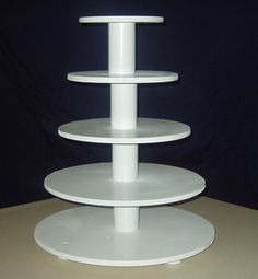 "My Cupcake Stand/Tower - 6, 8, 10, 12, 14""  masonite  circles,  Using pvc pipe as spacers, all thread through center with threaded bolt at top, drawer knobs for feet.    Thanks to all the other creative ccr's for their examples, sketches and directions for their cupcake towers."