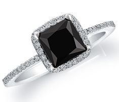 Sterling silver ring with a black .50ctw princess cut natural black onyx stone with a accent of white cz stones along side of the top square halo and the band.